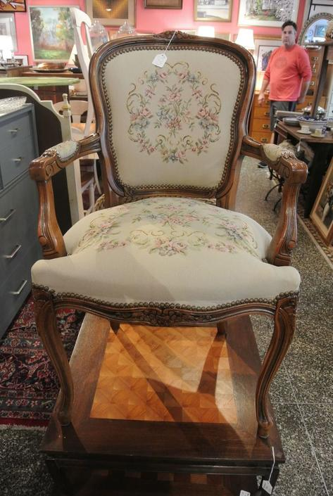 Upholstered needlepoint chair. $125