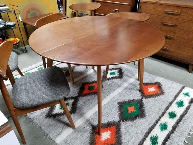 Mid-Century Modern round dining table with two 12\
