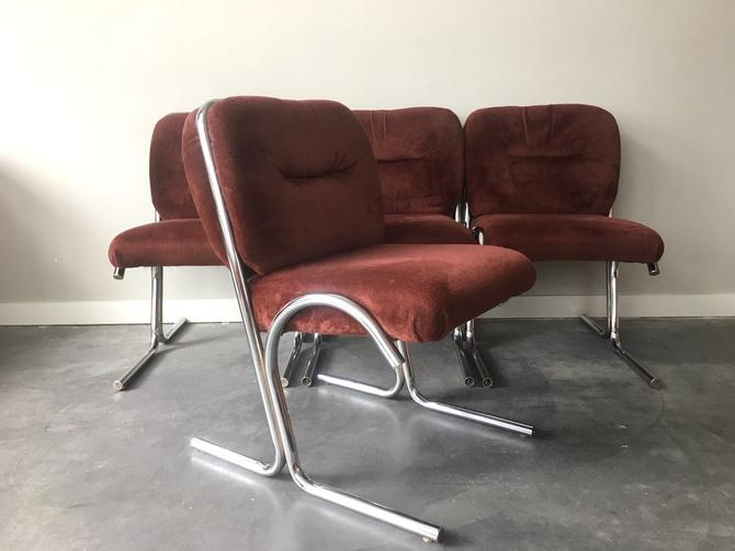 set of 4 vintage mid century modern chrome cantilever chairs.