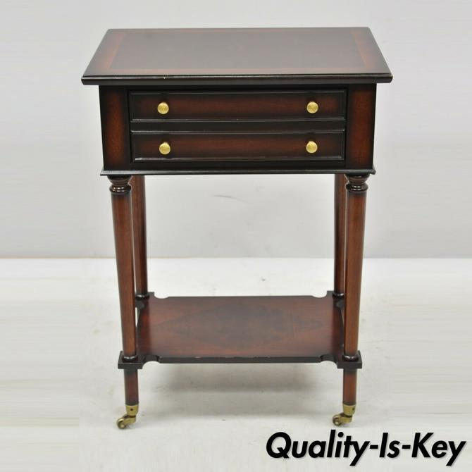 The Bombay Co. One Drawer Cherry Side Table with Brass Wheels and Shelf