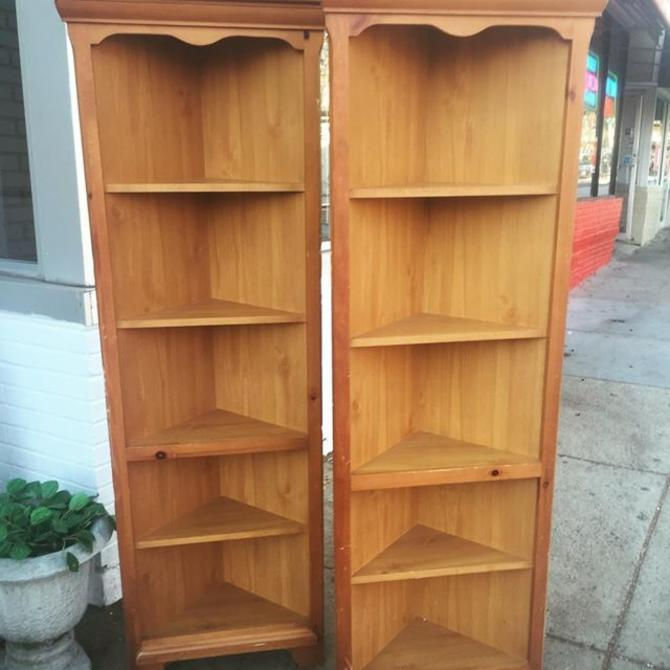 2 solid pine apartment-size corner shelves.