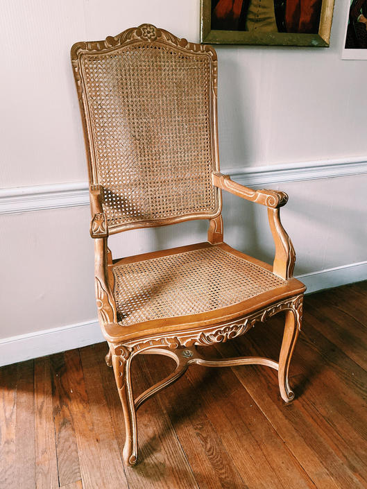 Carved Light Wood French Cane Arm Chair by VintageandSwoon