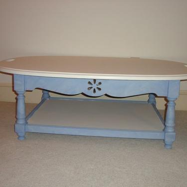 SOLD - Coffee table with an extra shelf.  The interesting thing about this piece is that it has cutouts on both sides on the top to be able to