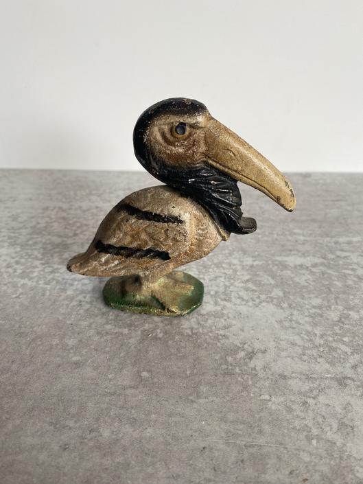 Mid Cent Cast Iron Pelican Bottle opener