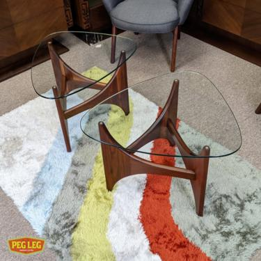 Pair of Mid-Century Modern sculpted walnut side tables by Adrian Pearsall