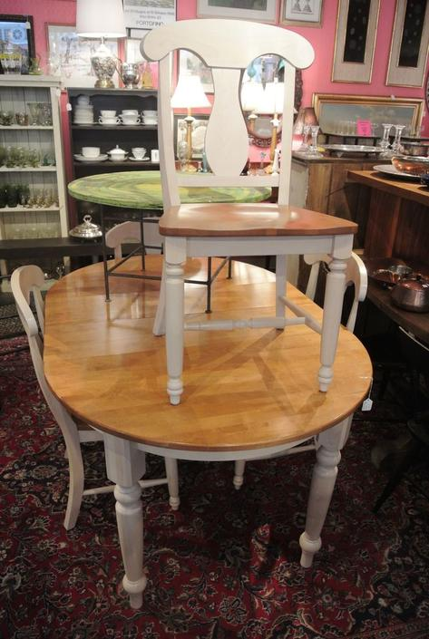 Oval table with one leaf and four chairs. $350