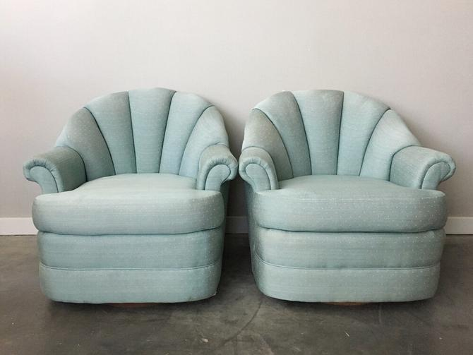 pair of vintage teal shell back swivel chairs.