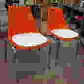 Vintage MCM pair of Orange fiberglass shell chairs
