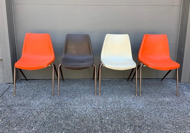 Set of 4 Mid Century Molded Plastic Stacking Chairs by DesertCactusVintage