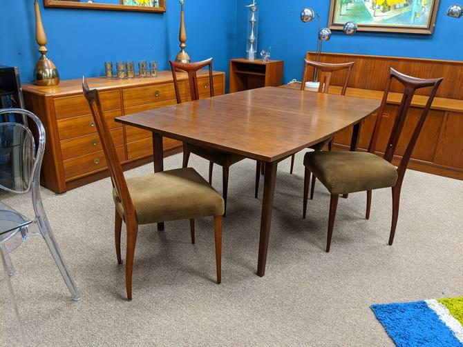 Mid-Century Modern walnut boat shape dining table with 2 leaves