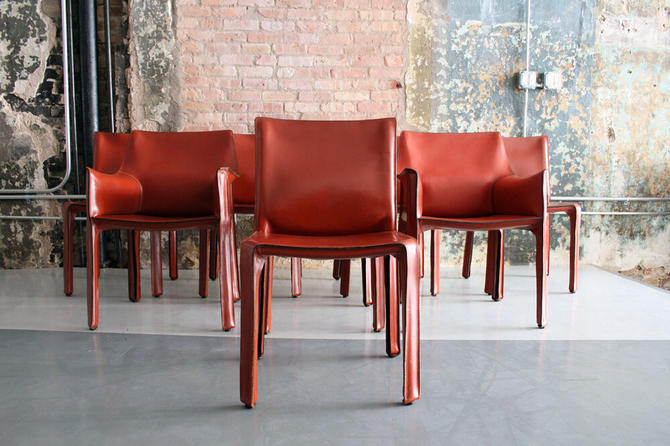 Set of 8 Cab dining chairs by Mario Bellini for Cassina Italy