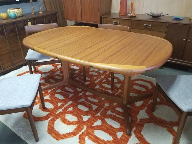 "Danish Modern teak oval dining table with two 18""leaves"