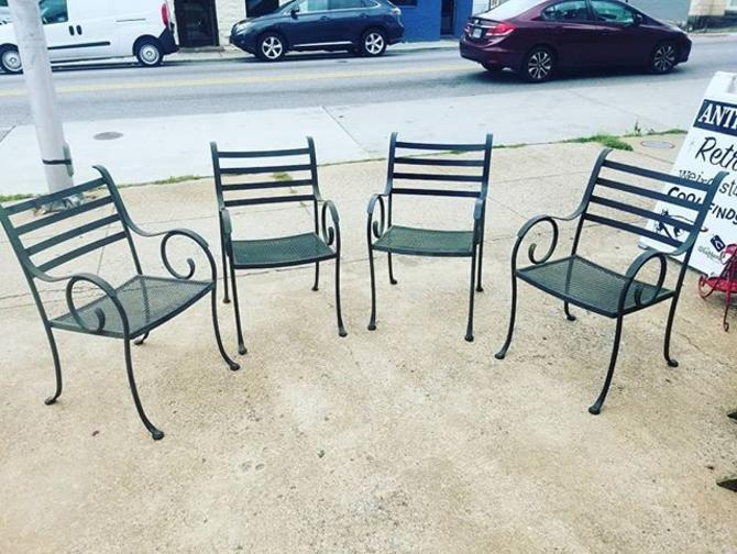 Set of 4 wrought iron outdoor chairs.