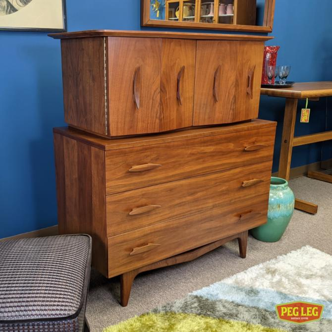 Walnut chest-on-chest dresser with bi-fold doors and sculpted pulls