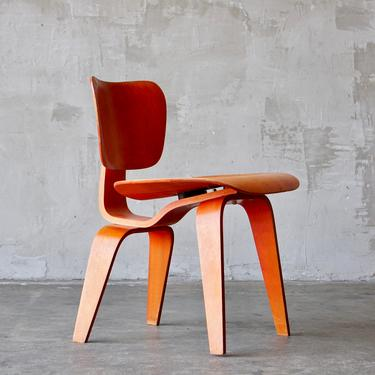 Eames/Evans Red Analine 'DCW' Chair by FandFVintage