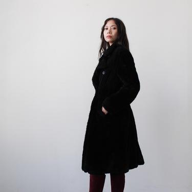 1990s DKNY black faux fur teddy coat by blossomvintageshop