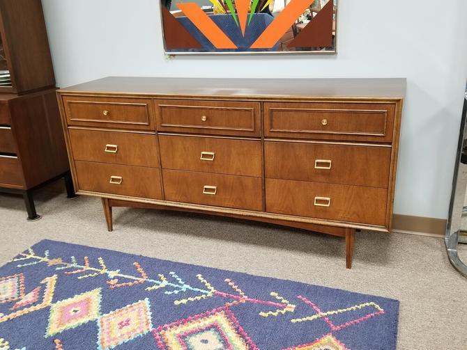 Mid-Century Modern walnut nine drawer dresser with brass pulls