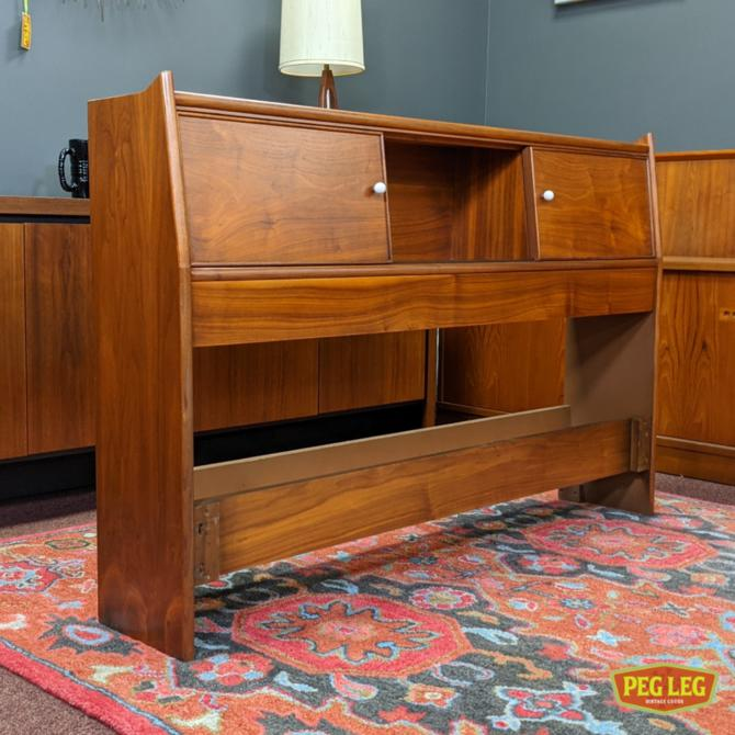 Mid-Century Modern full-size walnut storage headboard from the 'Declaration' collection by Drexel