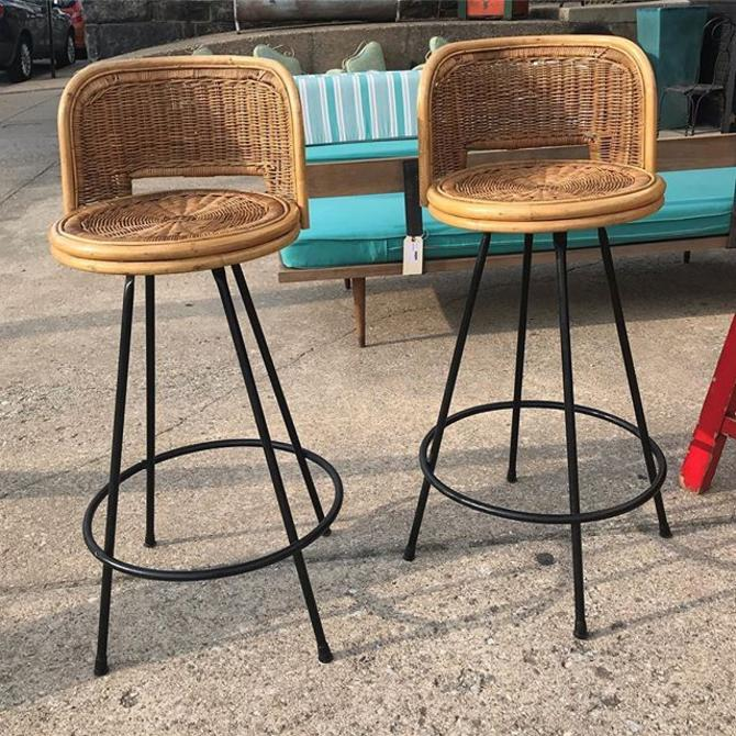 A pr of Mid Century cane and metal swivel barstools, by Danny Ho Fong. $375
