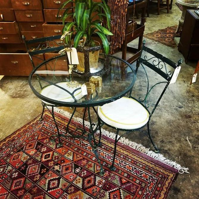 Glass top bistro table with two chairs