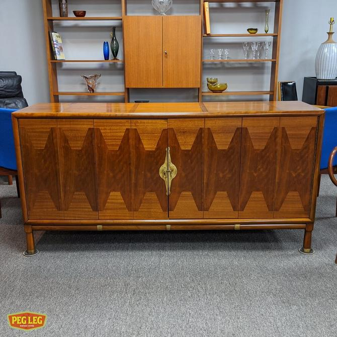 Mid-Century Modern walnut credenza with bi-fold doors and brass details
