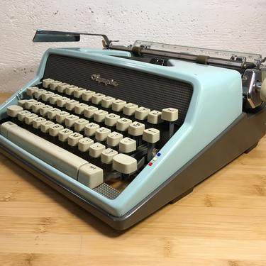 Blue 1963 Olympia SM7 Deluxe Portable Typewriter with Case, New 2 Color Ribbon + 2 Spanish Characters by Deco2Go