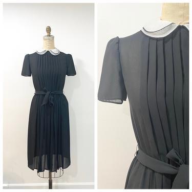 70s sheer black dress by harlowandspring