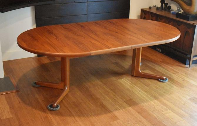 Restored Danish teak round-to-oval expandable dining table by Skovby Mobelfabrik by MidCenturyClever
