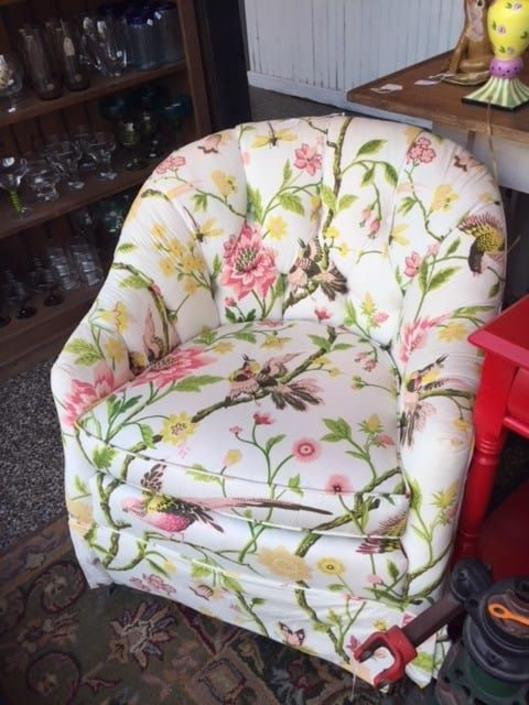 Floral upholstered chair. $250