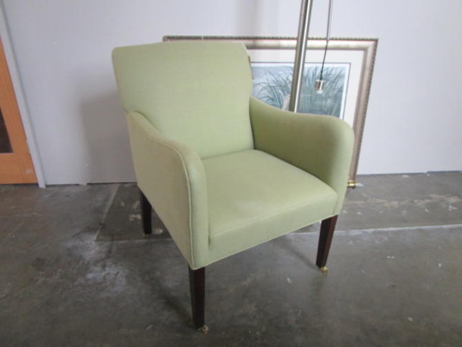 NEW UPHOLSTERED ARM CHAIR WITH CASTERS