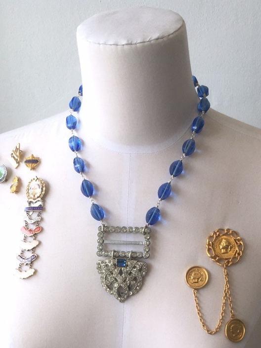 Speakeasy Secrets [assemblage necklace: vintage rhinestone buckle, rhinestone dress clip, antique glass beads] by nonasuch