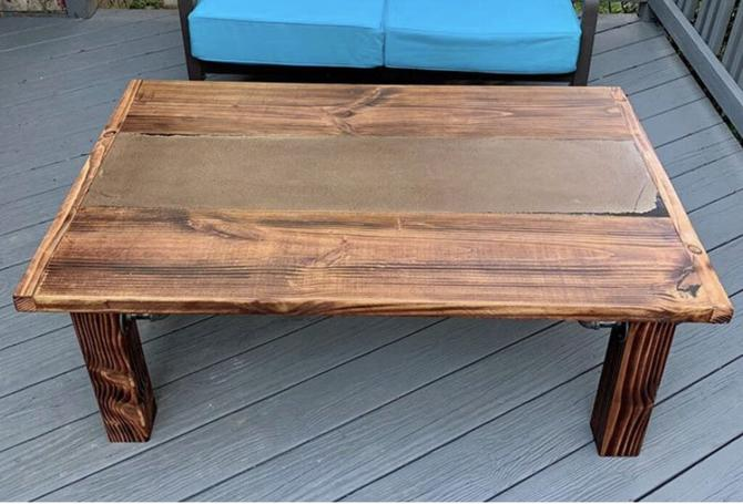 Coffee Table. Stained High Density Concrete Center, with Black Epoxy filled spots, Honey Stained Shou Sugi Ban Wood frame and base, with Black Steel Pipe Accents
