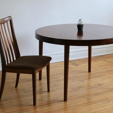 Mid Century Danish Modern Rosewood Round/Oval Dining Table by SpacedOutFurniture