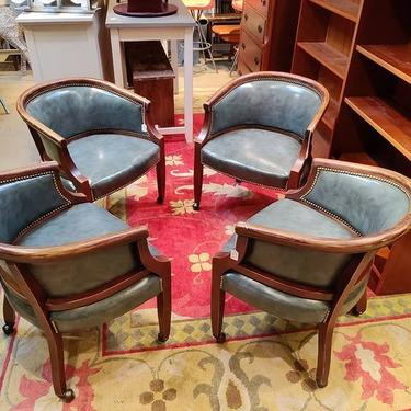 Classic blue vinyl wheeled club chairs. 25