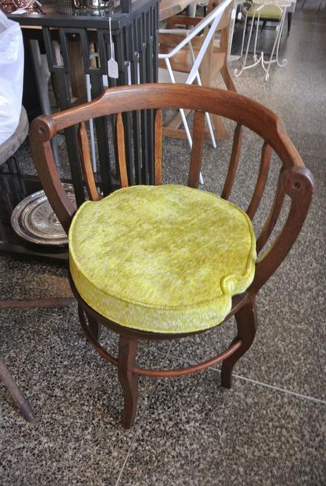 Wood chair with yellow cushion. $70