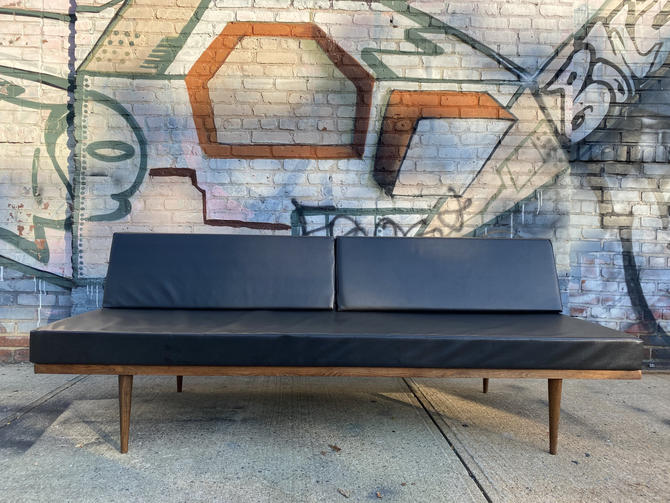Mid century modern minimalist danish daybed sofa couch bed black frame original black vinyl faux snakeskin leather upholstery by symmetrymodern