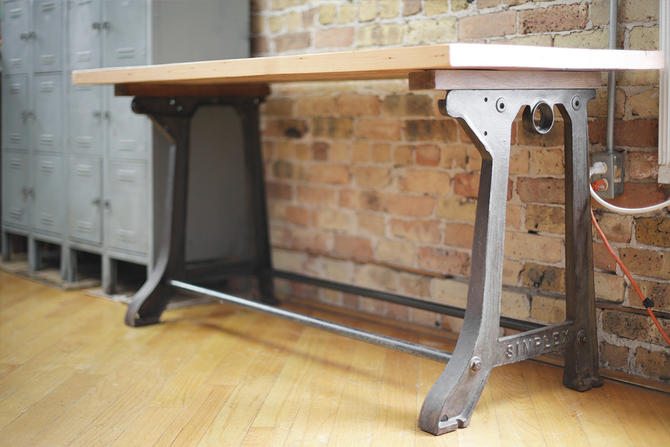 vintage table with Simplex cast iron base and custom wood top by jeglova