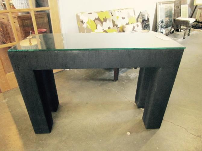 BLACK FABRIC WRAPPED CONSOLE TABLE WITH GLASS TOP