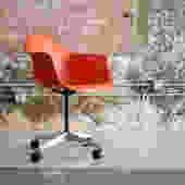 Eames Orange Swivel chair on wheeels