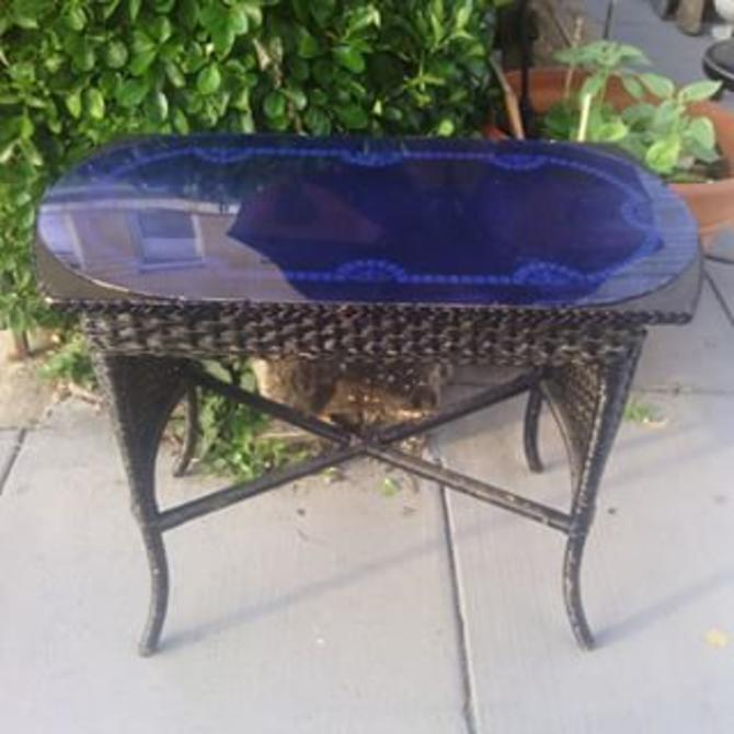 Vintage Black Wicker Desk Table Staged With Blue Deco Mirror