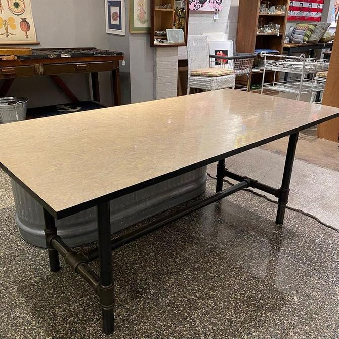 "Industrial table with pipe legs, 71""L x 36""W x 30""H"