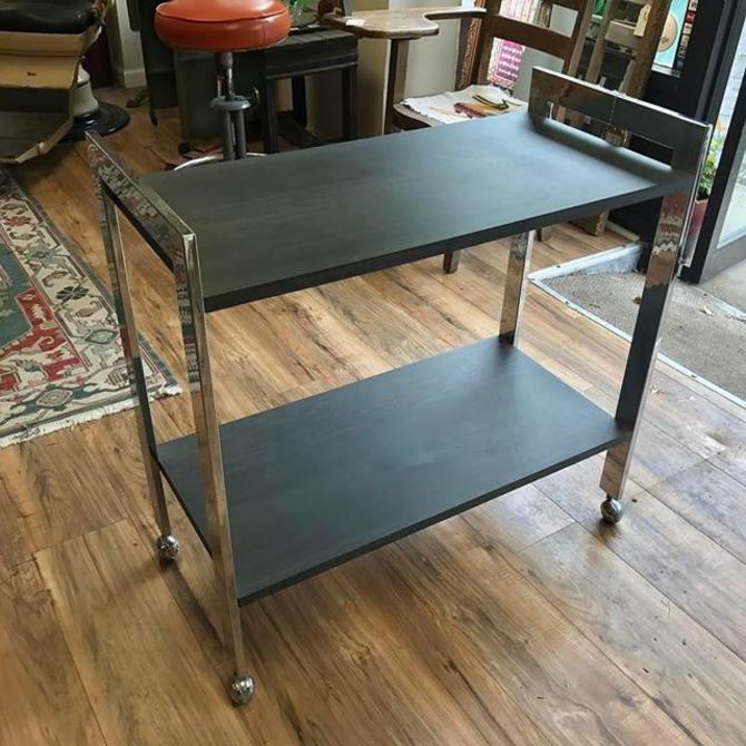 Bar cart. Looks like slate (slate like laminate) and chrome frame. $150. Wishbone Reserve