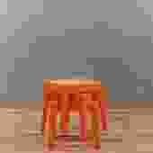 Trio of Retro Orange Plastic Stacking Tables