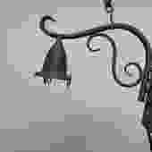 Outdoor lantern style sconce