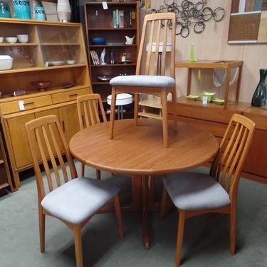 Set of four Danish Modern teak highback dining chairs