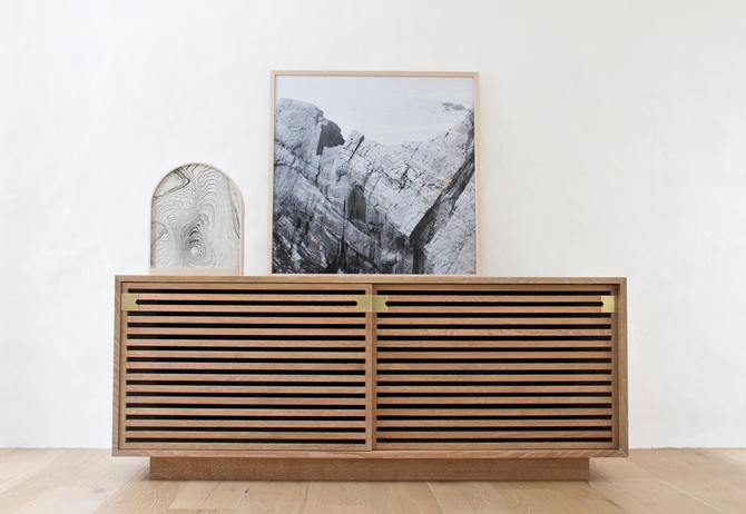 Slatted Media Console - White oak tv stand with slatted sliding doors by wrenandcooper