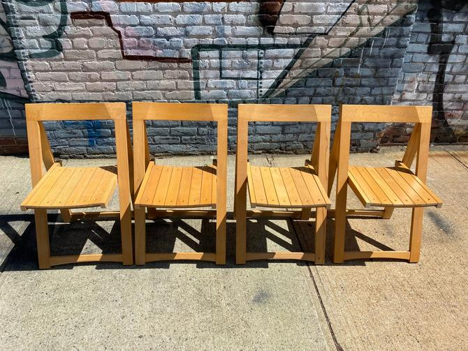 Mid century modern danish folding nesting Blonde hardwood brass dining chairs (4) dining chairs by symmetrymodern