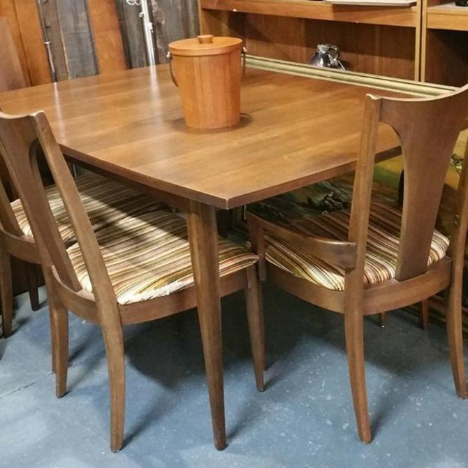 Mid-century walnut dining room set. Brasilia by Broyhill. Dining table with  one leaf and five chairs. $595.