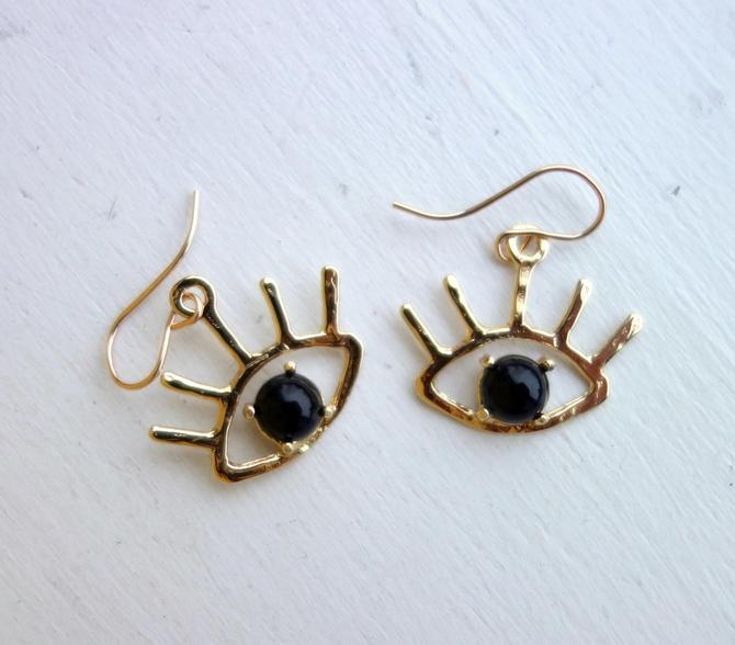 Beholder Earrings: Brass and Black Onyx Eye Dangle Earrings by RachelPfefferDesigns