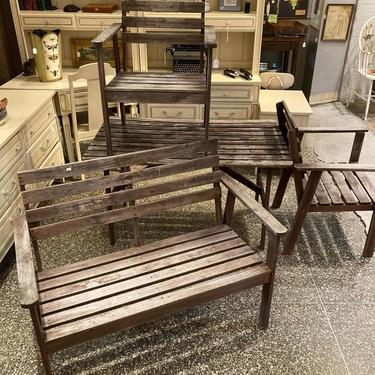 4 piece patio set. Table, two chairs and a bench.